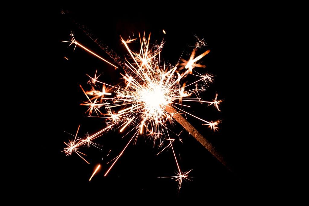 Firecracker igniting in the dark.